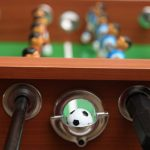 kick legend foosball table ball return closeup